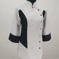 The cook's jacket is female